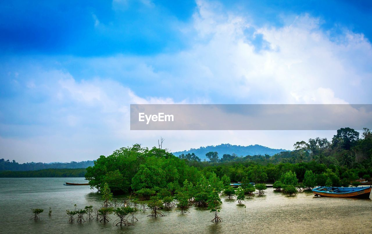 water, sky, nature, cloud - sky, scenics, tranquility, tranquil scene, beauty in nature, tree, river, nautical vessel, waterfront, outdoors, no people, mountain, day, landscape, growth