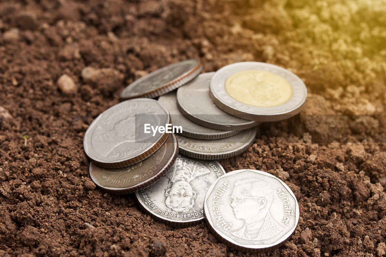 finance, coin, currency, wealth, business, still life, no people, metal, close-up, savings, focus on foreground, investment, group of objects, high angle view, economy, indoors, silver colored, day, variation, finance and economy