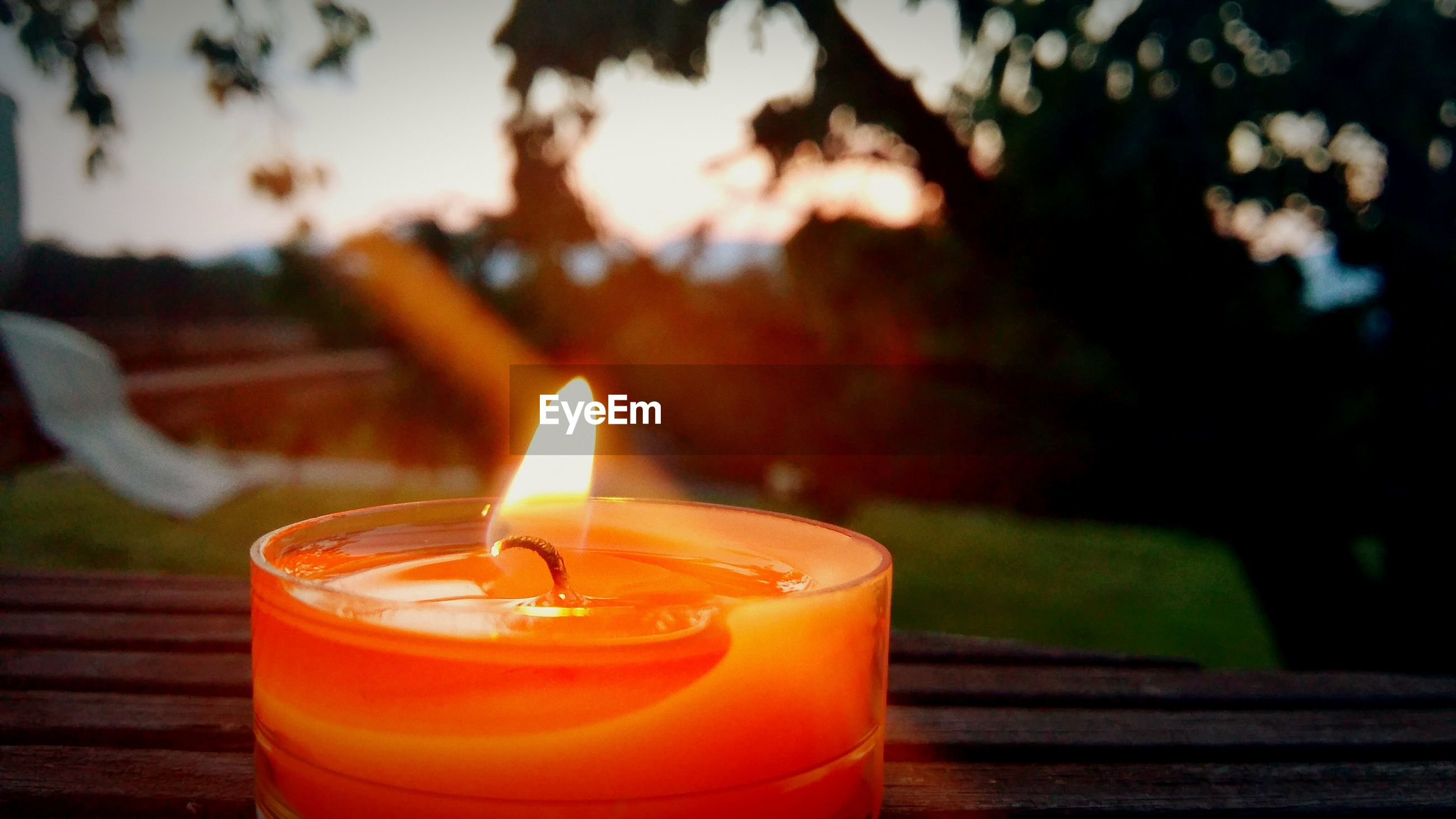 burning, flame, candle, heat - temperature, fire - natural phenomenon, glowing, illuminated, lit, close-up, focus on foreground, fire, candlelight, indoors, drink, glass - material, tea light, orange color, selective focus, lighting equipment, light - natural phenomenon