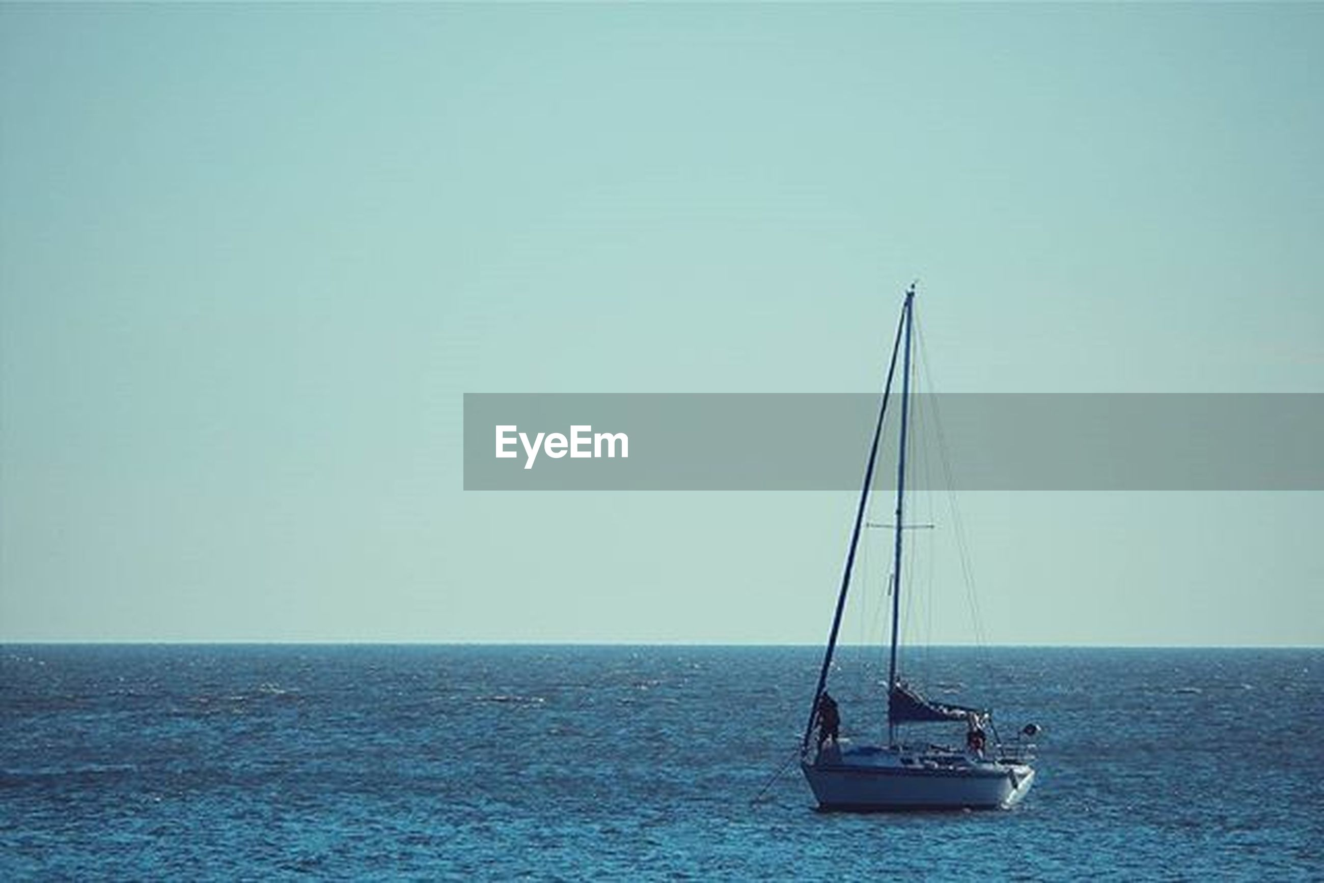 sea, horizon over water, water, nautical vessel, transportation, clear sky, copy space, mode of transport, boat, waterfront, tranquil scene, tranquility, sailing, scenics, beauty in nature, nature, blue, sailboat, rippled, outdoors