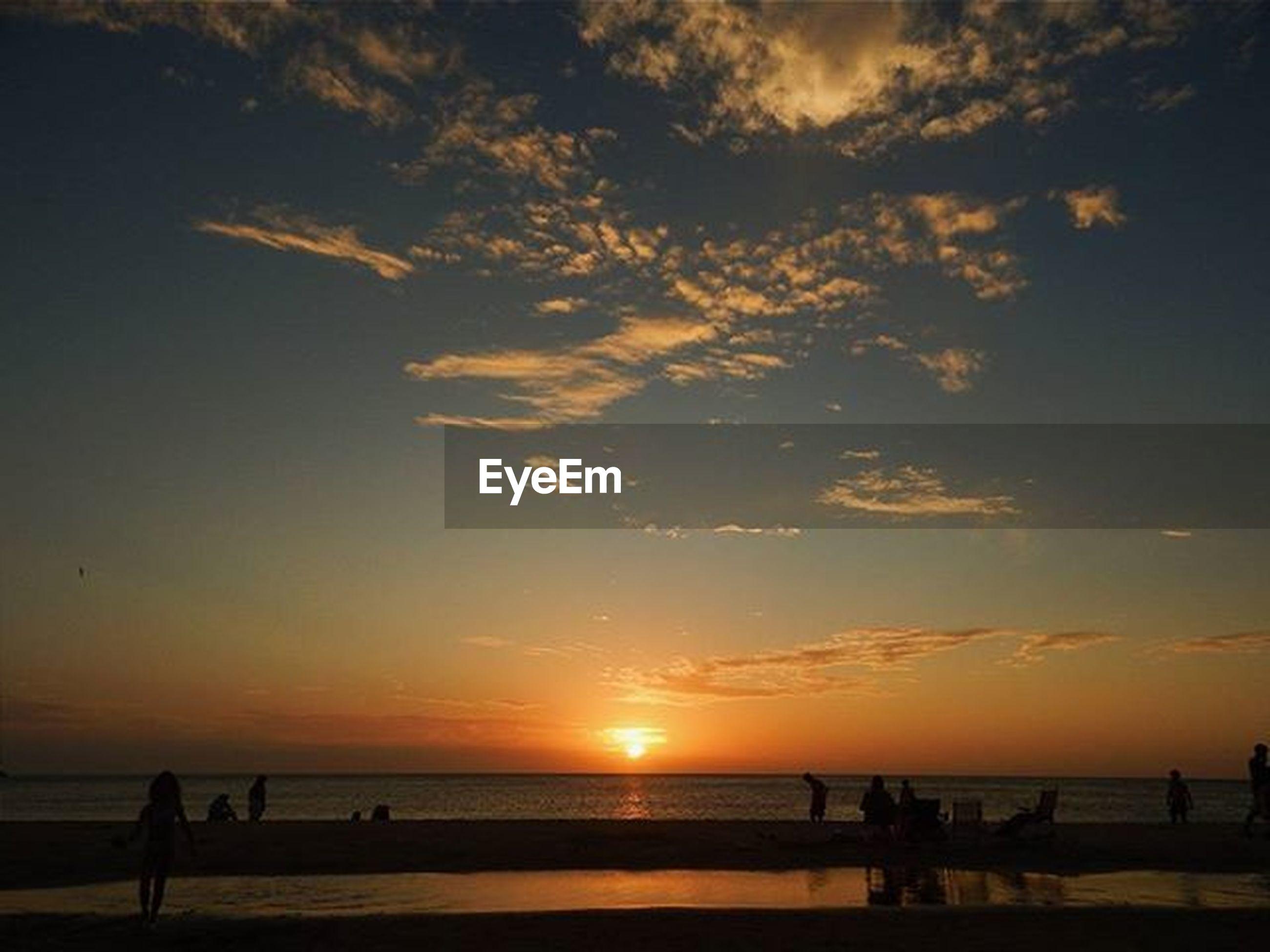 sunset, sea, horizon over water, water, scenics, silhouette, sun, beauty in nature, sky, tranquil scene, tranquility, orange color, idyllic, beach, nature, cloud - sky, sunlight, incidental people, cloud, shore