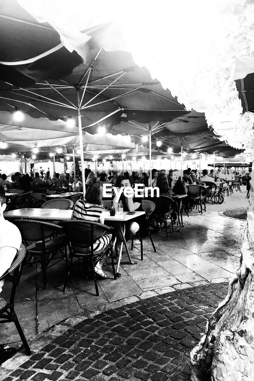 seat, real people, cafe, chair, business, table, restaurant, architecture, sidewalk cafe, group of people, women, adult, lifestyles, people, crowd, sitting, city, men, leisure activity, outdoors