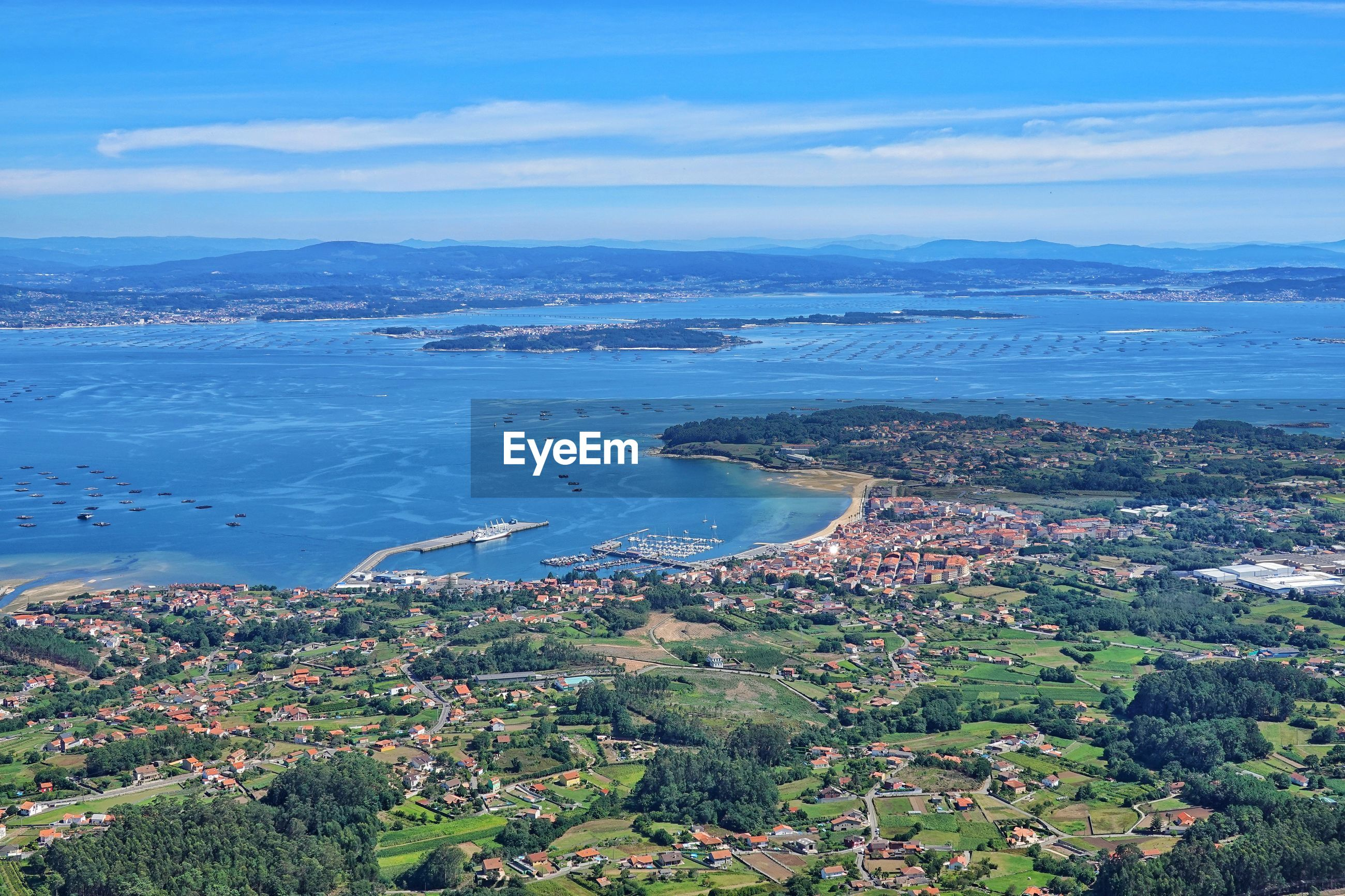 HIGH ANGLE VIEW OF SEA AND BAY AGAINST SKY