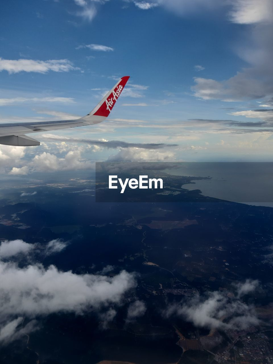 cloud - sky, sky, air vehicle, nature, flying, airplane, no people, day, red, aerial view, outdoors, mid-air, motion, scenics - nature, mode of transportation, mountain, transportation, beauty in nature, aircraft wing, environment