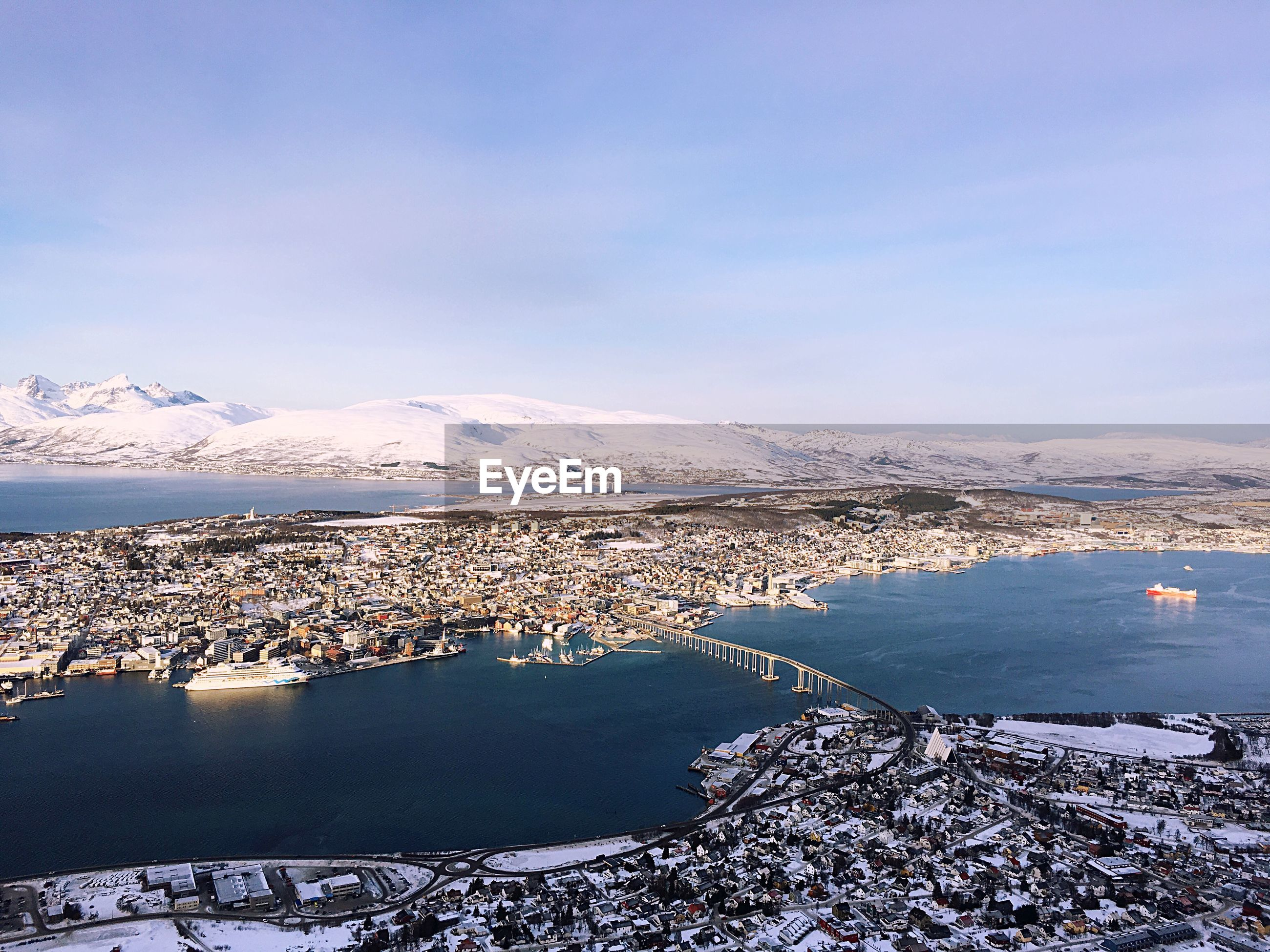 AERIAL VIEW OF CITY BY SEA DURING WINTER
