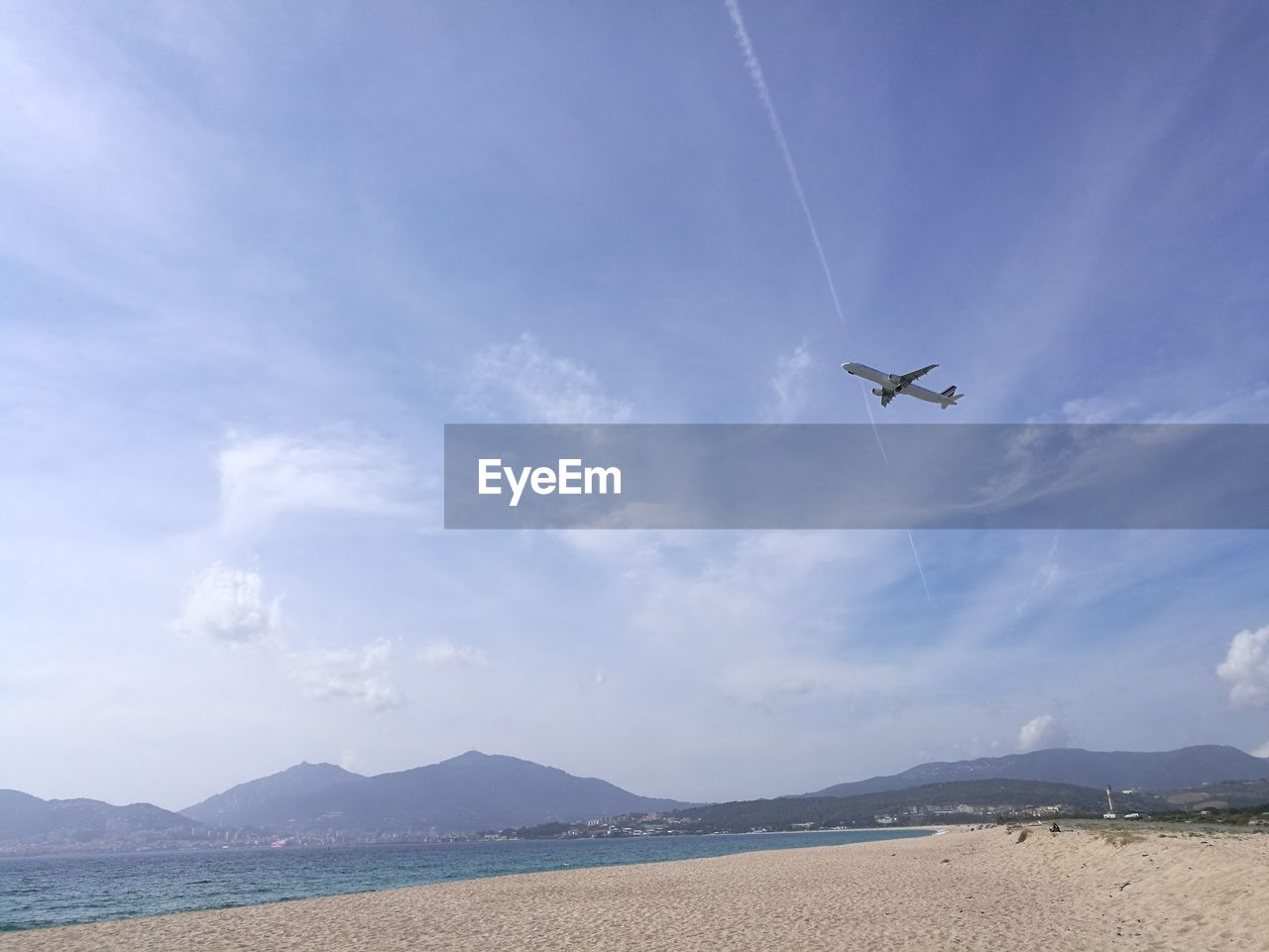 sky, cloud - sky, mode of transportation, transportation, airplane, flying, air vehicle, beauty in nature, nature, travel, scenics - nature, mountain, no people, day, on the move, low angle view, non-urban scene, mid-air, motion, outdoors, plane