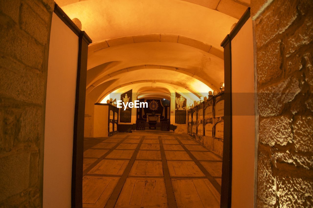 indoors, the way forward, corridor, architecture, built structure, arch, illuminated, no people, day