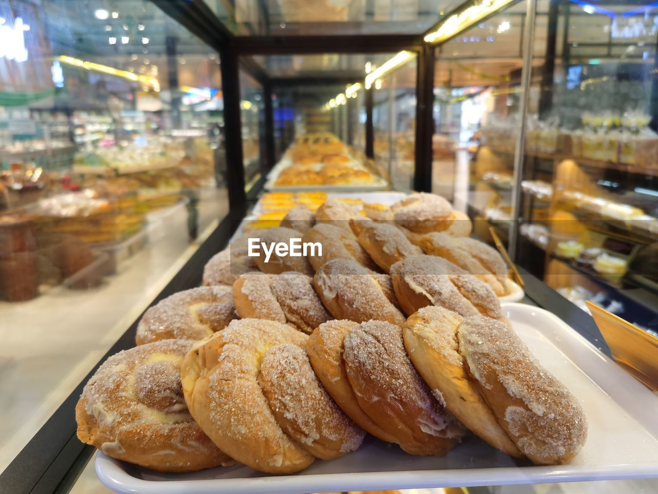 CLOSE-UP OF BREAD IN STORE FOR SALE AT TABLE