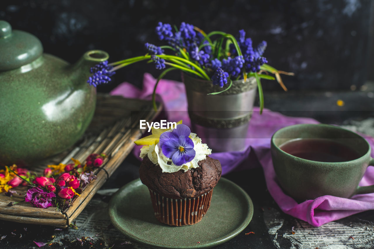 freshness, food and drink, sweet food, flower, flowering plant, plant, dessert, food, sweet, indulgence, cake, temptation, baked, table, ready-to-eat, no people, close-up, purple, nature, still life, chocolate cake
