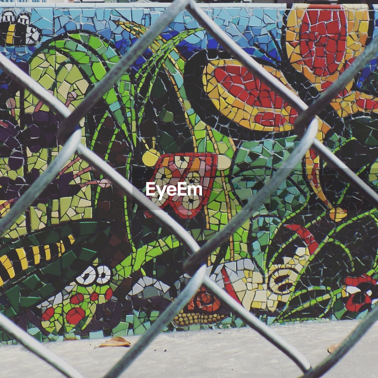 chainlink fence, text, metal, day, no people, outdoors, city, close-up
