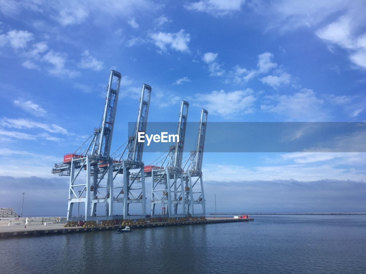 water, industry, cloud - sky, sky, transportation, sea, nautical vessel, business, shipping, freight transportation, waterfront, commercial dock, nature, harbor, crane - construction machinery, architecture, machinery, pier, day, no people, outdoors, construction equipment