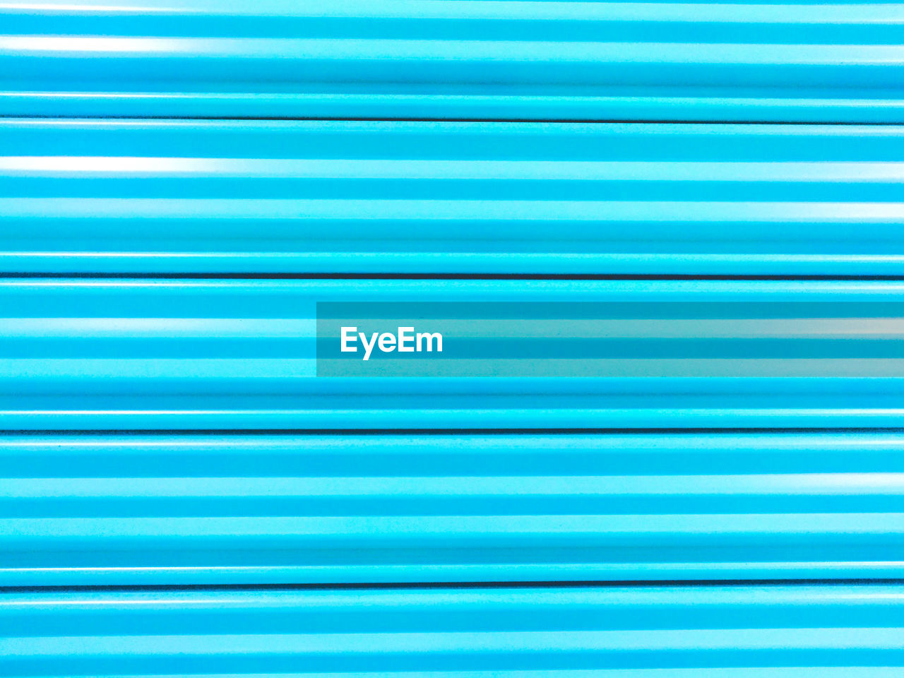 Full Frame Shot Of Blue Metallic Surface