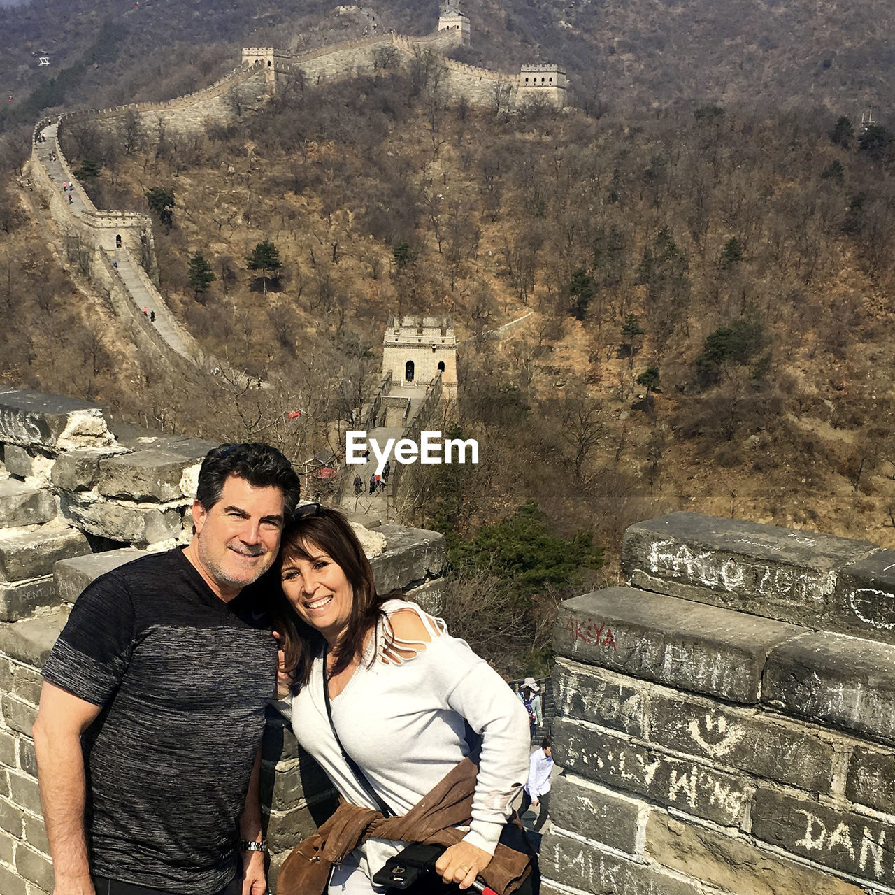 Portrait of smiling mature couple at great wall of china