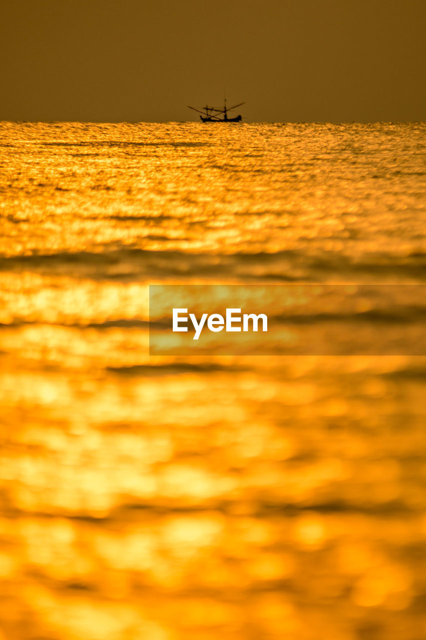 transportation, mode of transportation, nautical vessel, water, sunset, waterfront, sky, sea, orange color, beauty in nature, scenics - nature, nature, tranquility, no people, outdoors, sailing, silhouette, tranquil scene, motion, sailboat