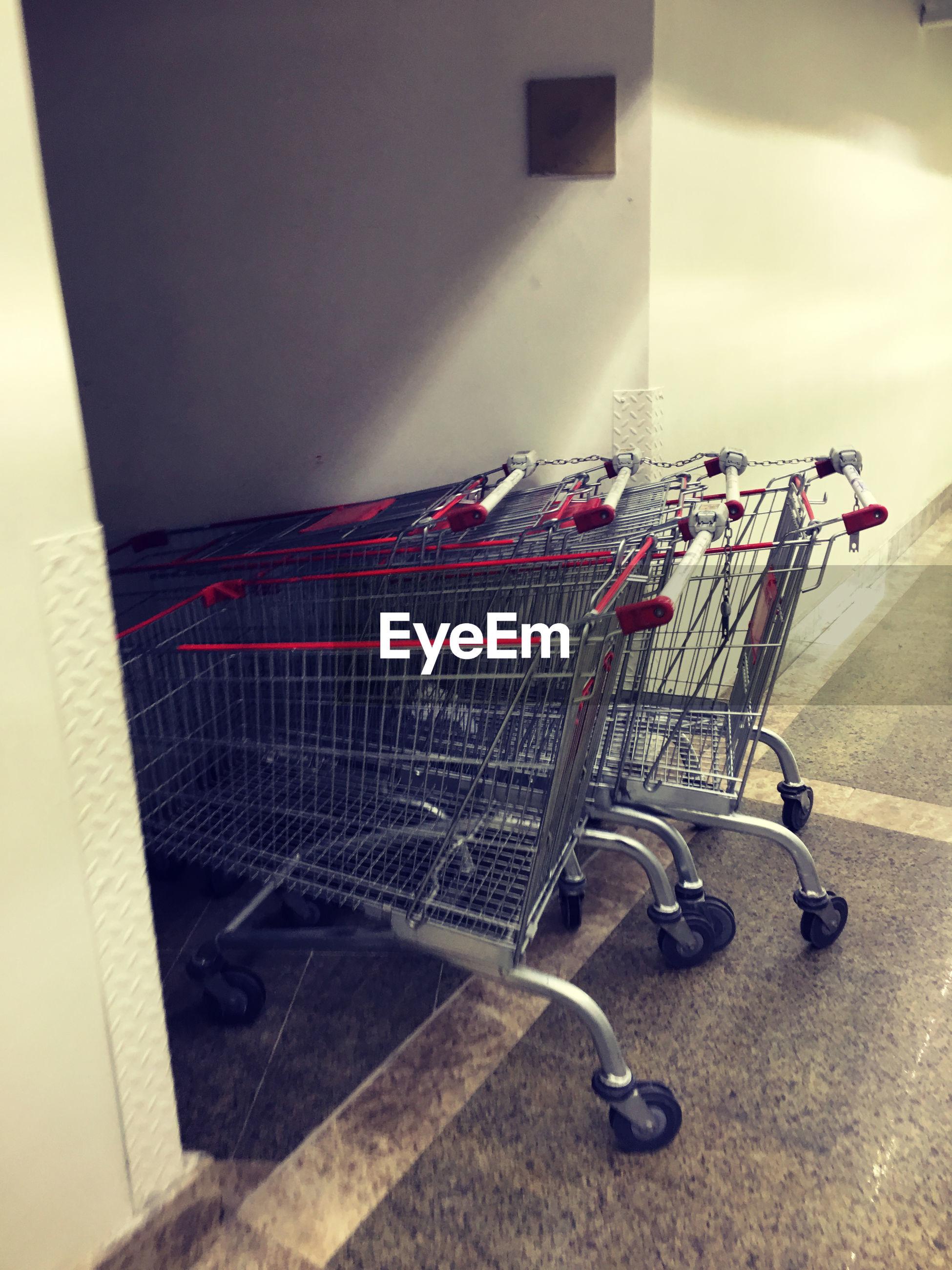 Close-up of shopping cart in corridor