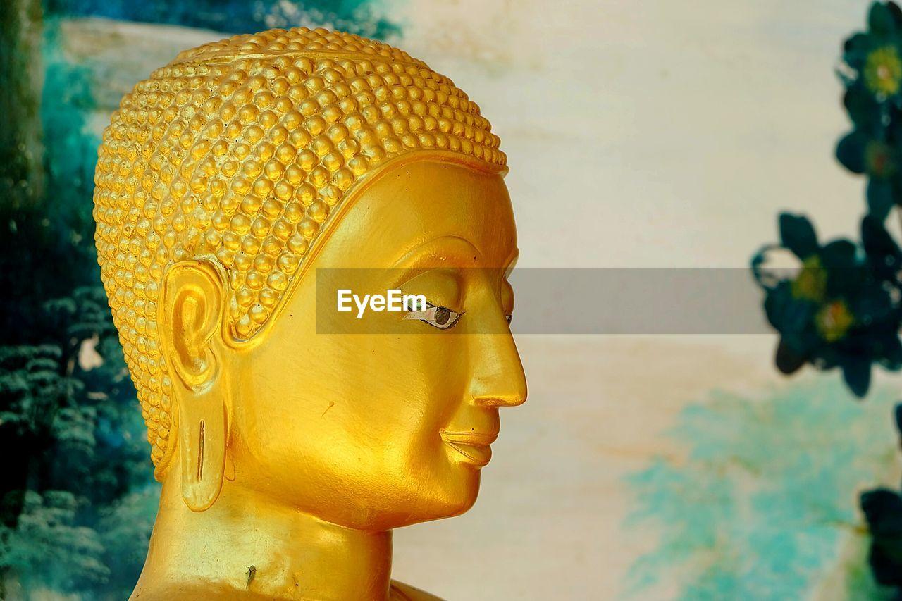 Close-Up Of Golden Buddha Statue