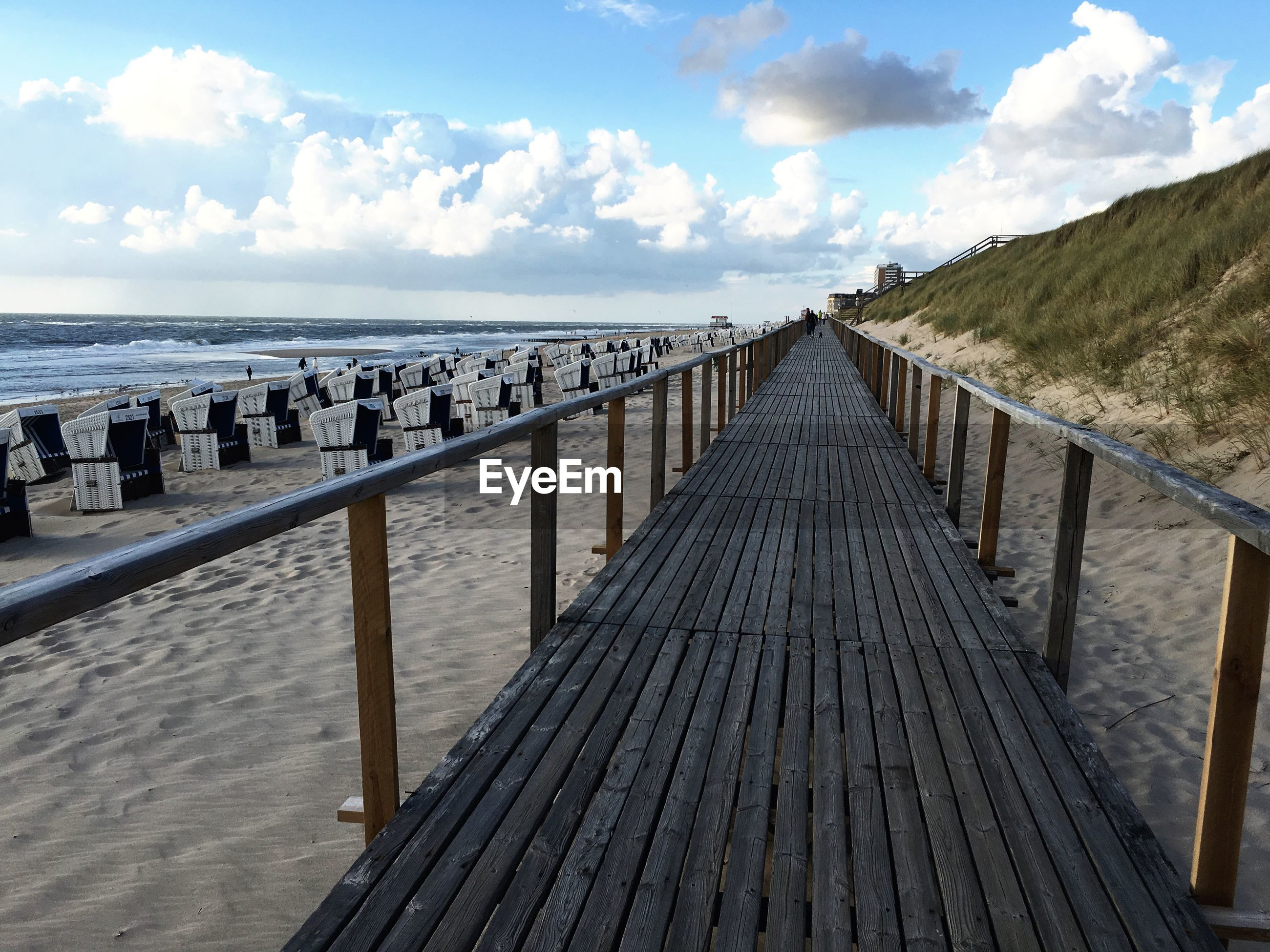 WOODEN WALKWAY LEADING TO SEA