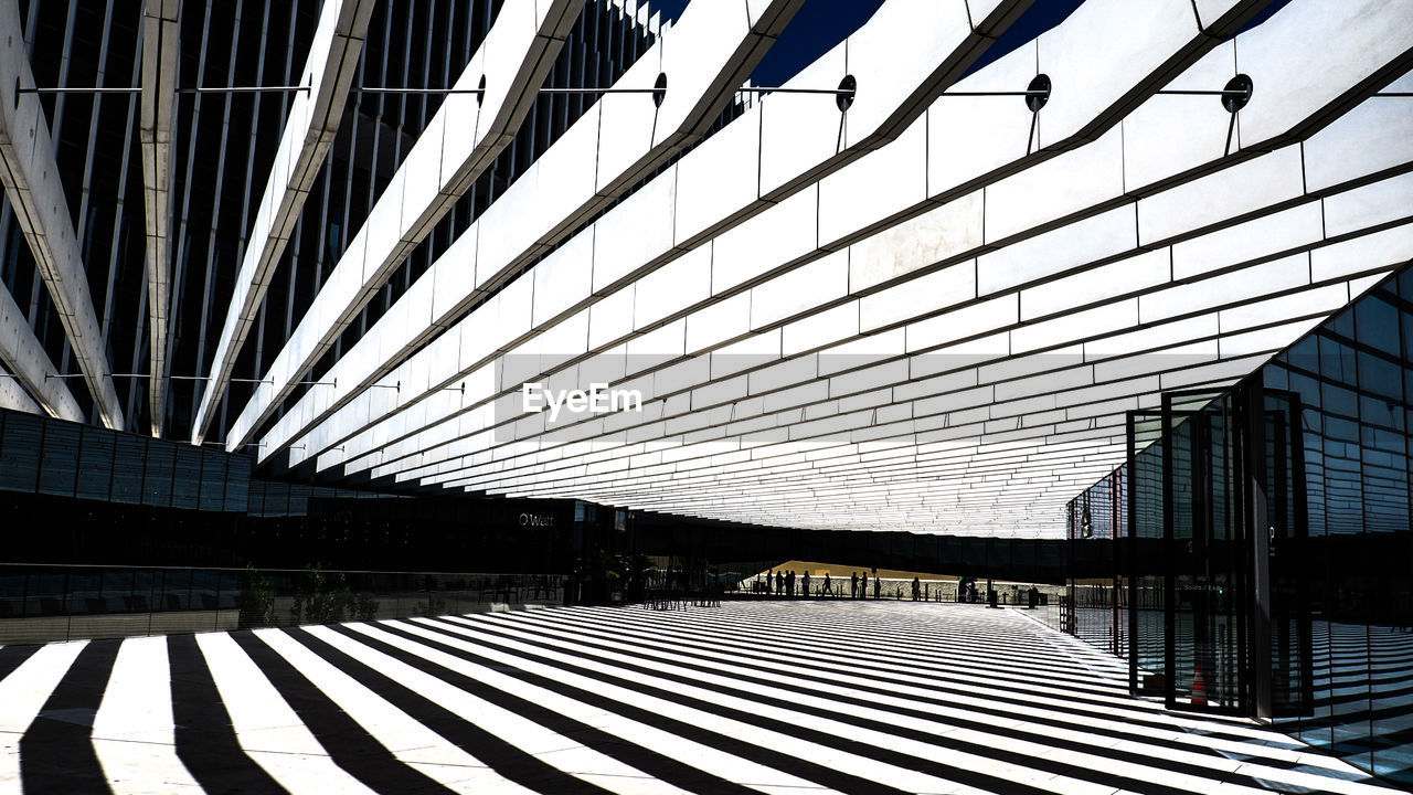 architecture, built structure, pattern, building exterior, day, no people, modern, building, sunlight, nature, ceiling, glass - material, outdoors, empty, city, shadow, reflection, flooring, transportation, office building exterior