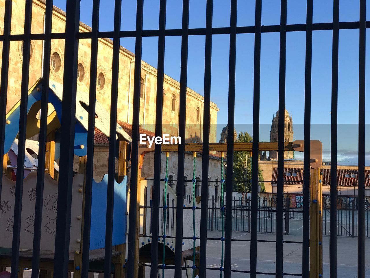 architecture, built structure, sky, metal, building exterior, barrier, building, security, fence, boundary, no people, protection, reflection, nature, outdoors, window, day, safety, blue, city