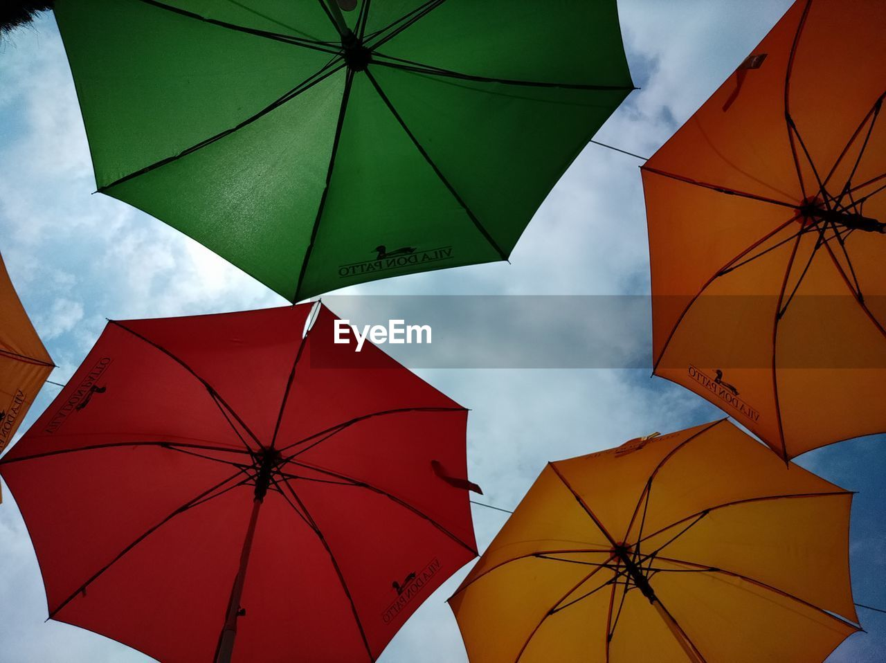 LOW ANGLE VIEW OF UMBRELLA AGAINST SKY DURING RAINY SEASON