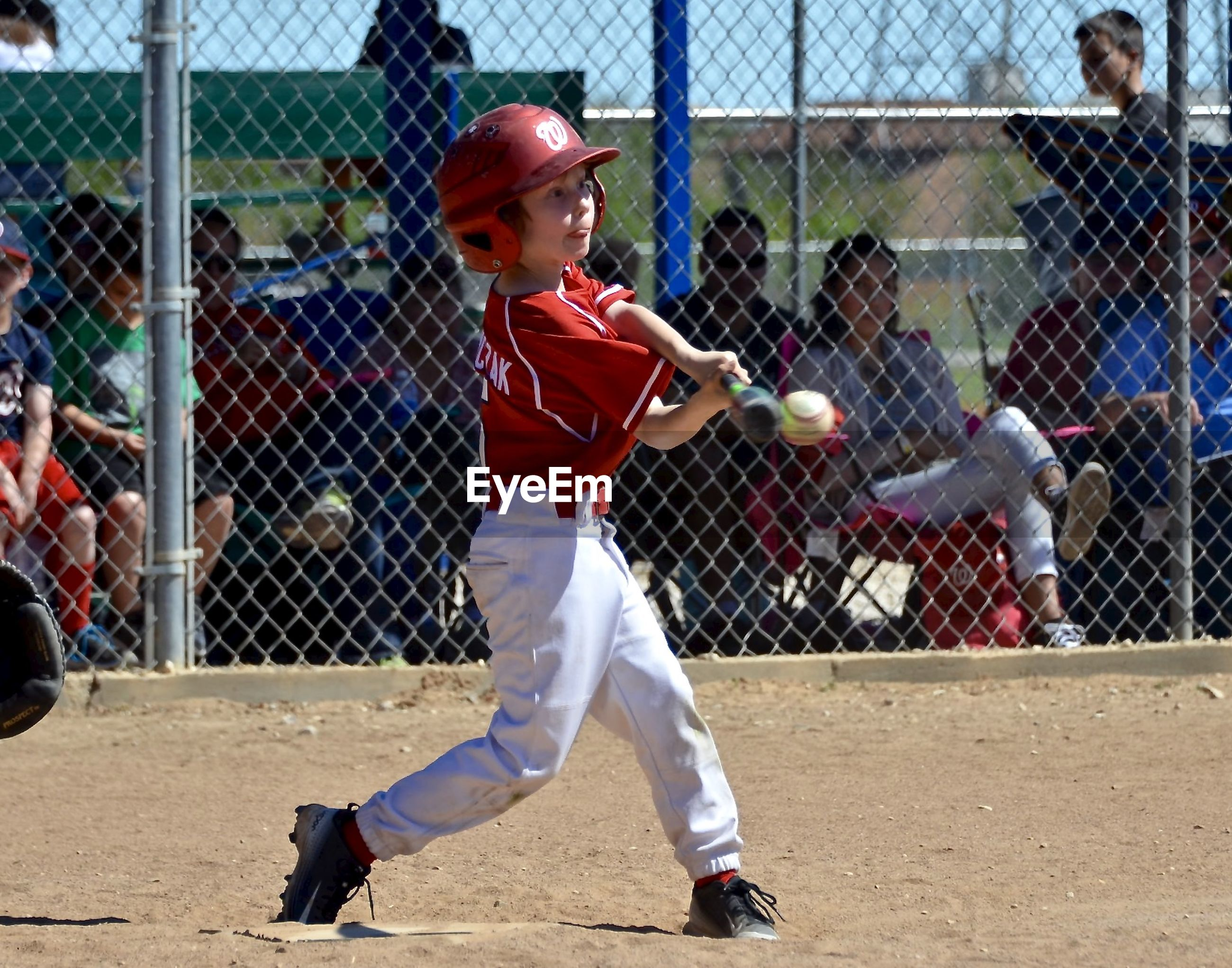 Side view of boy playing baseball on field