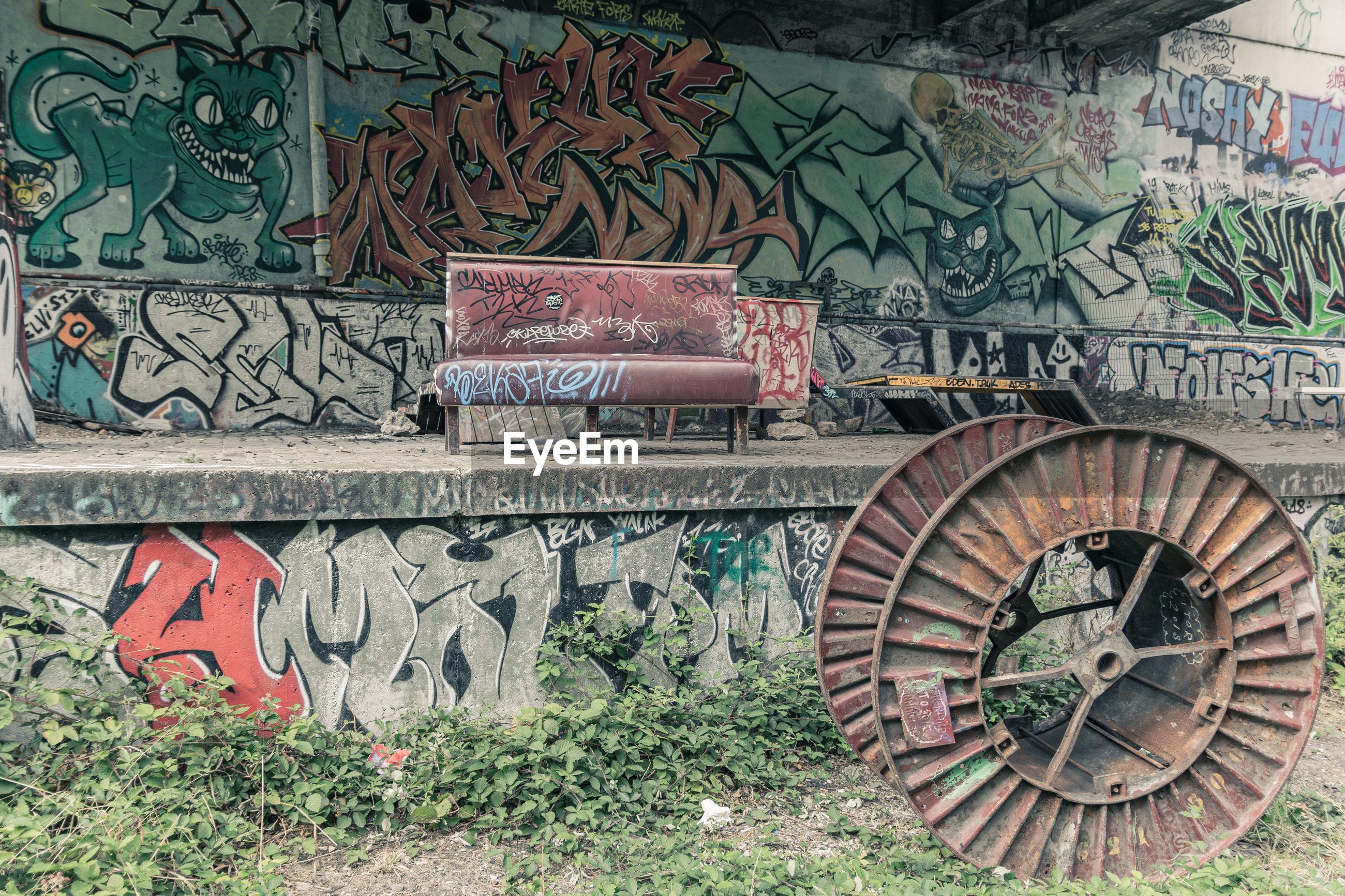 GRAFFITI ON WALL OF OLD WALLS