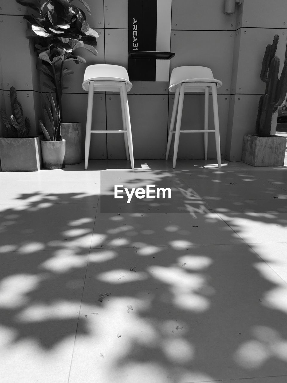 seat, chair, shadow, flooring, sunlight, table, indoors, no people, nature, day, absence, home interior, furniture, empty, tile, tiled floor, relaxation, domestic room, business, surface level