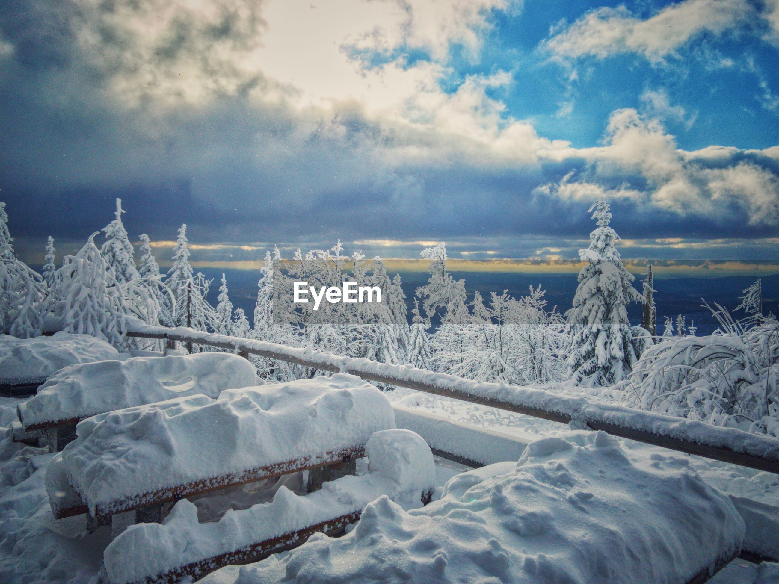 Snow covered shore against sky