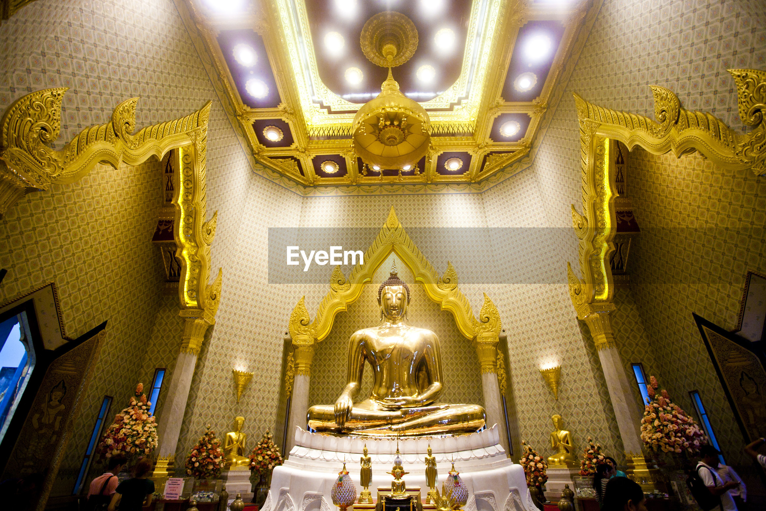 Low angle view of illuminated statue in temple