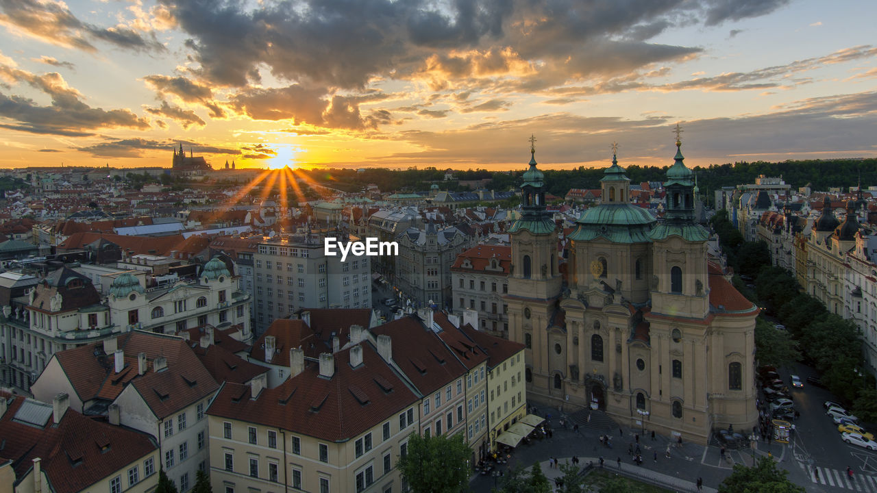 building exterior, built structure, architecture, sunset, city, cloud - sky, sky, building, residential district, cityscape, crowded, crowd, nature, high angle view, orange color, town, outdoors, travel destinations, townscape