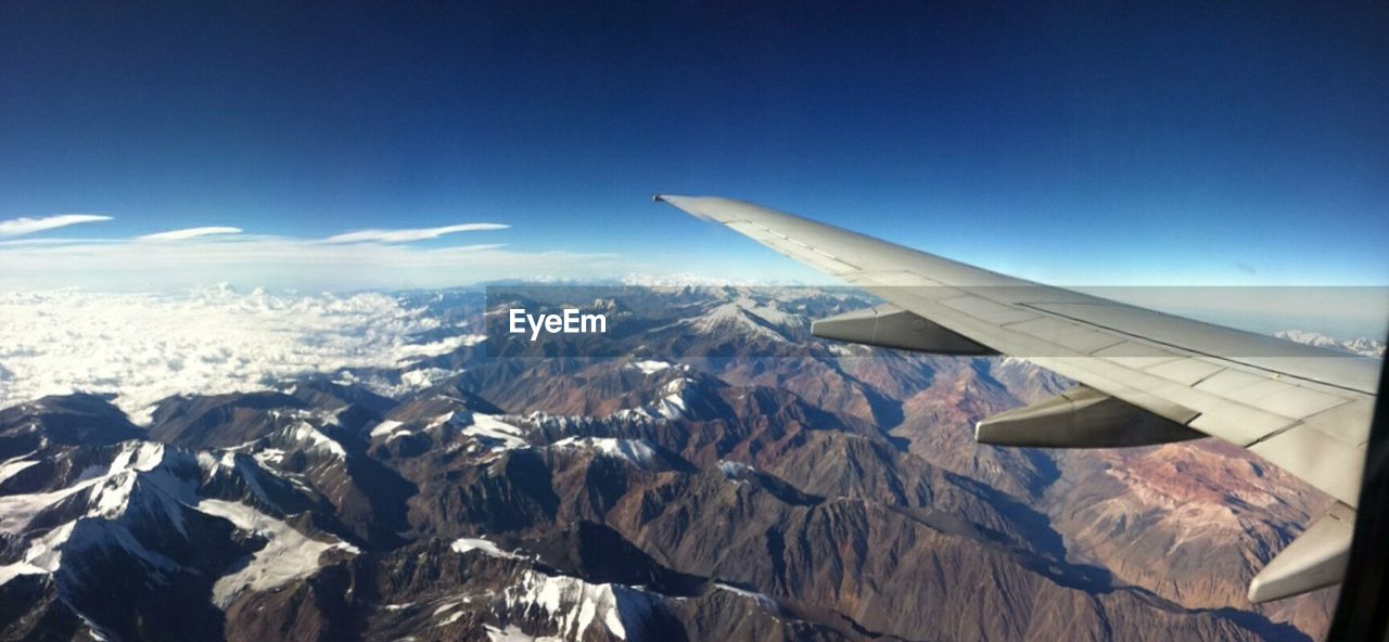 airplane, flying, nature, no people, aircraft wing, aerial view, outdoors, day, air vehicle, mountain, scenics, landscape, sky, blue, beauty in nature, airplane wing
