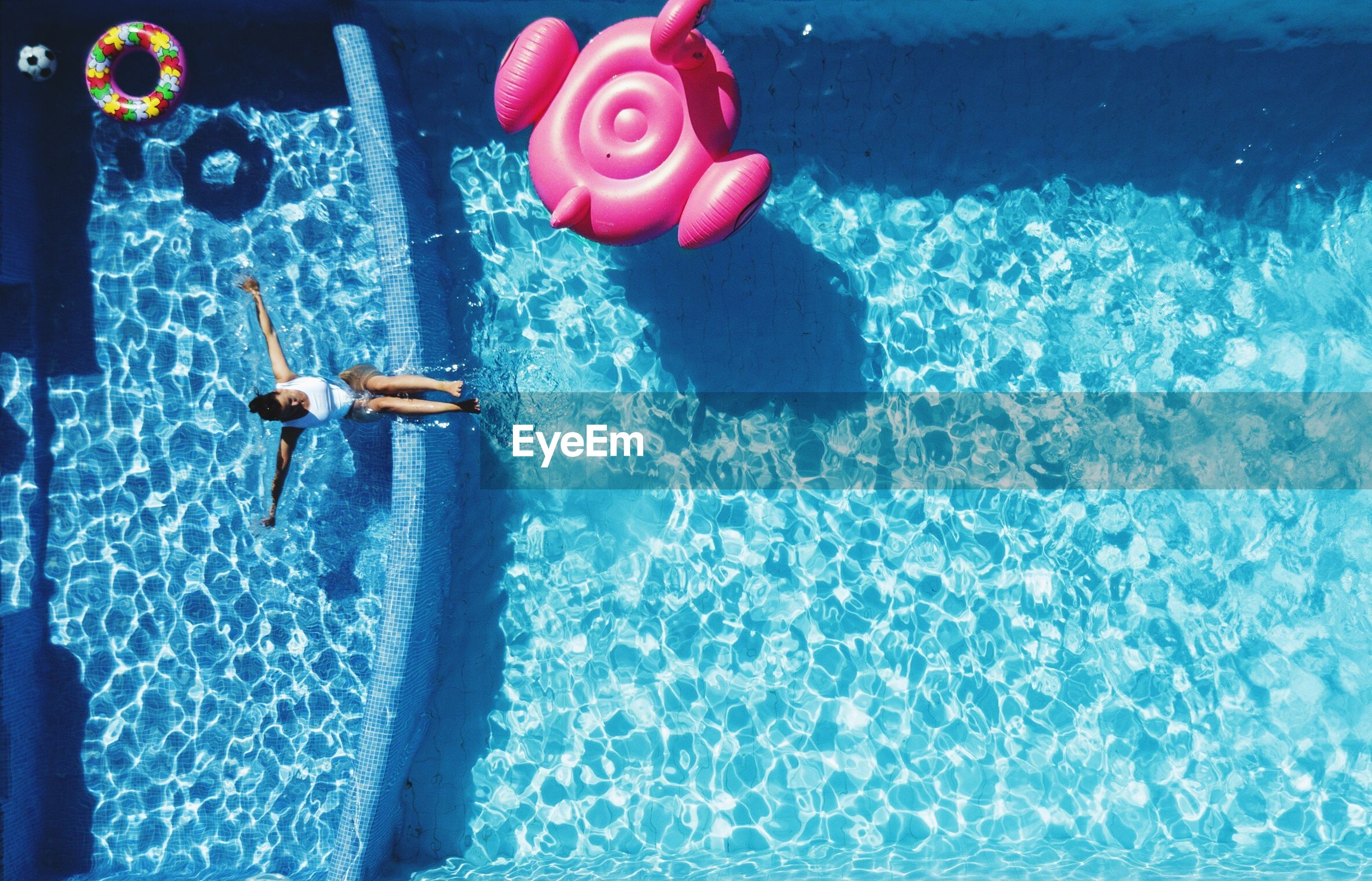 High angle view of woman swimming in pool