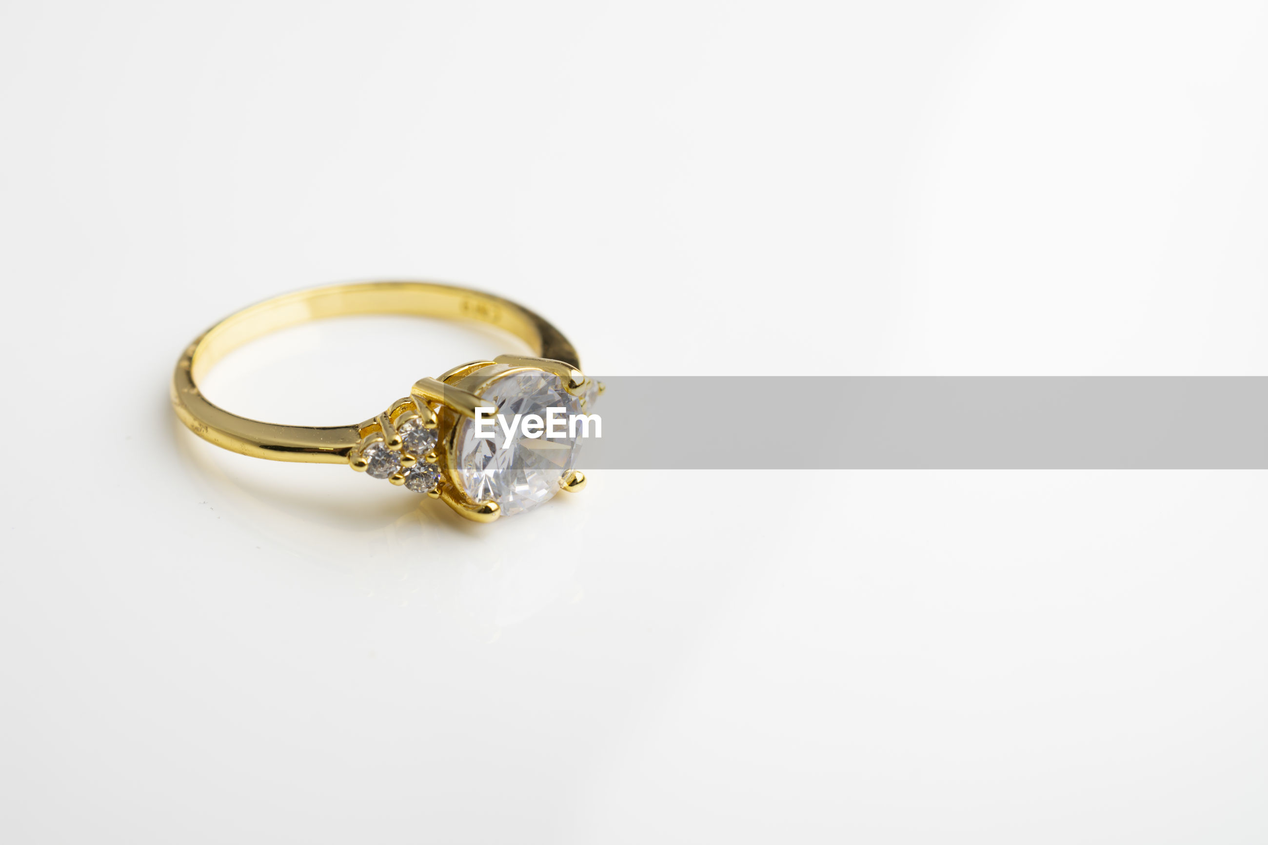 Close-up of diamond ring on white background