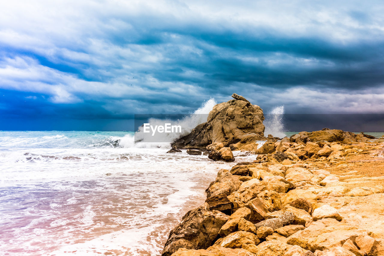 sea, cloud - sky, rock, water, sky, rock - object, solid, beauty in nature, scenics - nature, beach, motion, rock formation, land, wave, nature, horizon over water, idyllic, horizon, no people, outdoors, power in nature, breaking