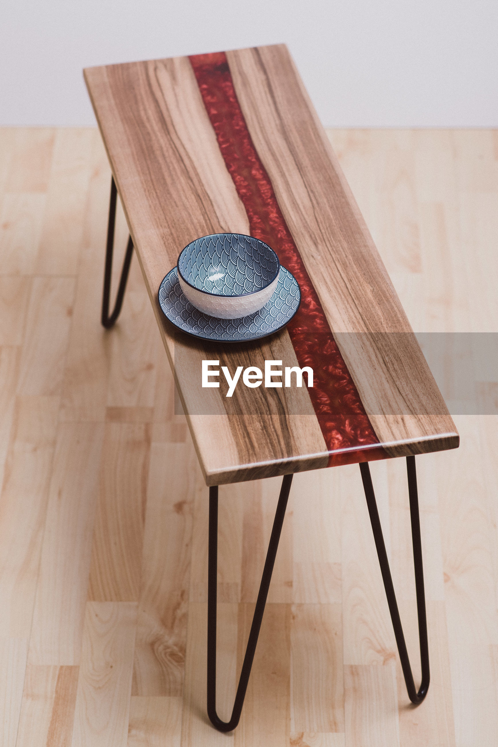 High angle view of crockery on table against wall