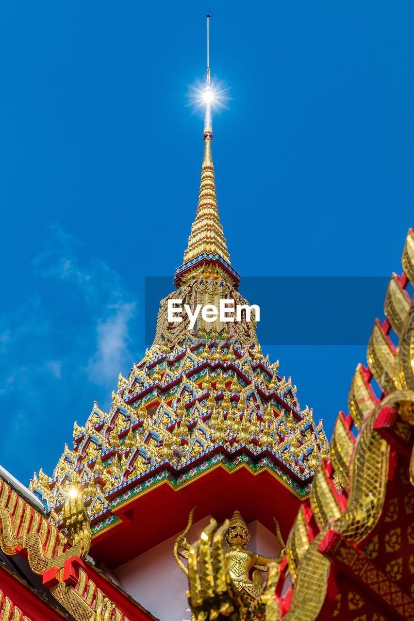 religion, place of worship, spirituality, architecture, low angle view, gold colored, built structure, building exterior, pagoda, travel destinations, no people, sky, outdoors, clear sky, day