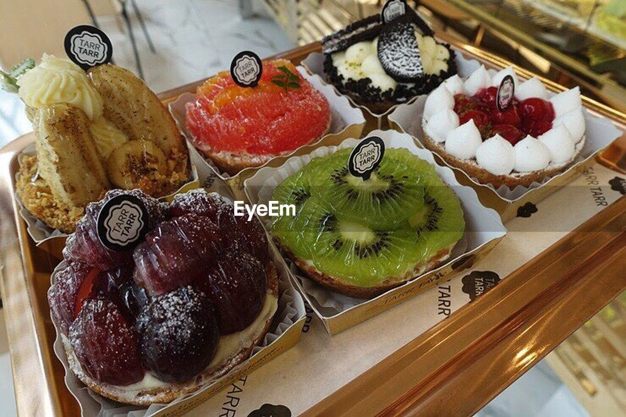 food and drink, indulgence, dessert, freshness, sweet food, food, temptation, ready-to-eat, still life, table, indoors, unhealthy eating, no people, cake, high angle view, plate, serving size, variation, fruit, close-up, day