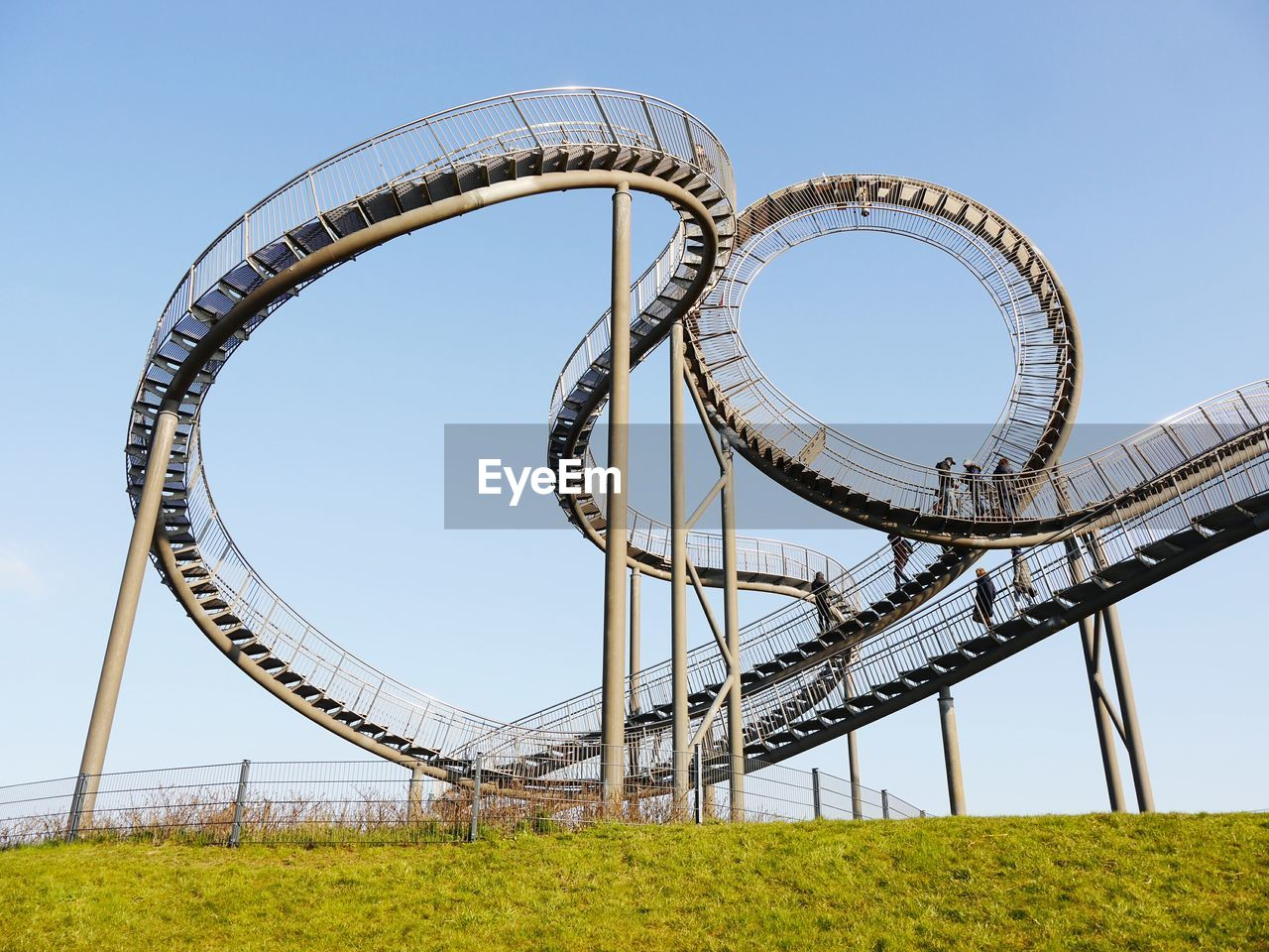 Low Angle View Of Roller Coaster Tracks Against Clear Sky