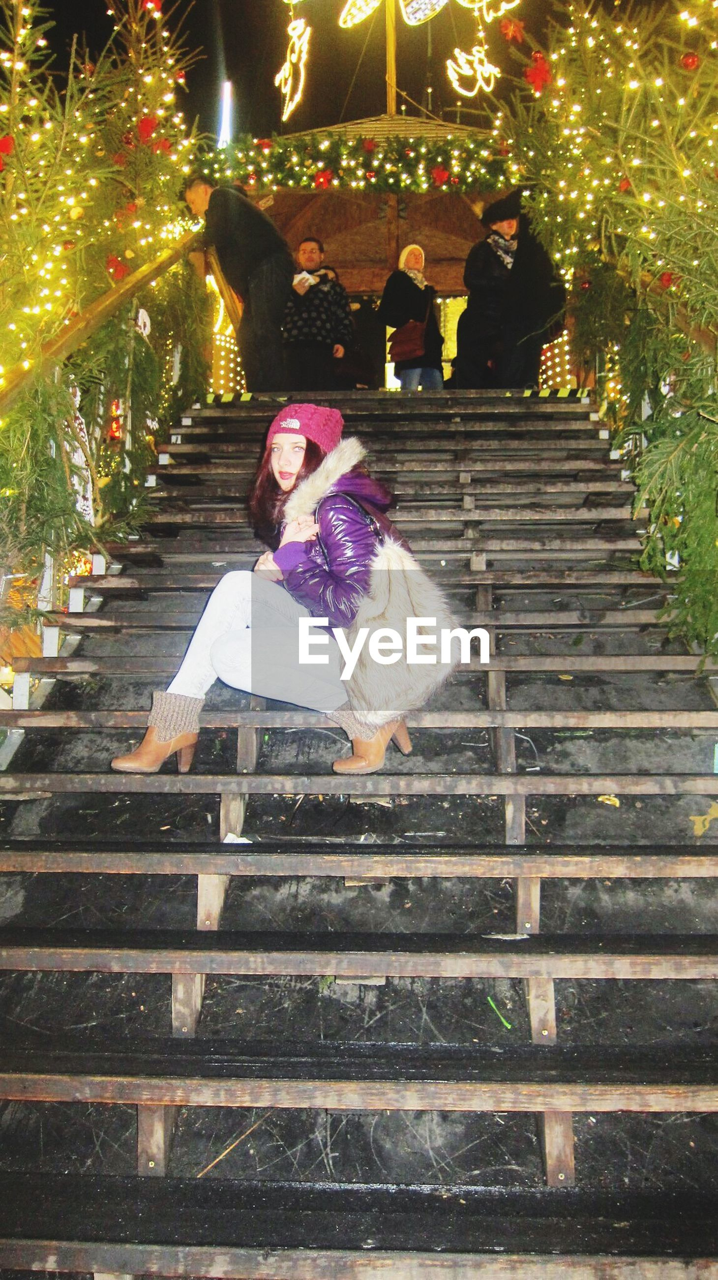steps, steps and staircases, railing, night, staircase, park - man made space, illuminated, tree, built structure, outdoors, leisure activity, lifestyles, sunlight, building exterior, architecture, standing, full length, wood - material