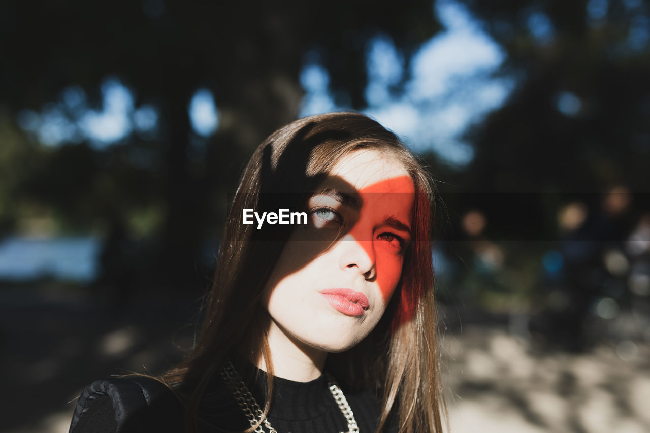 Red reflection on eyes of woman