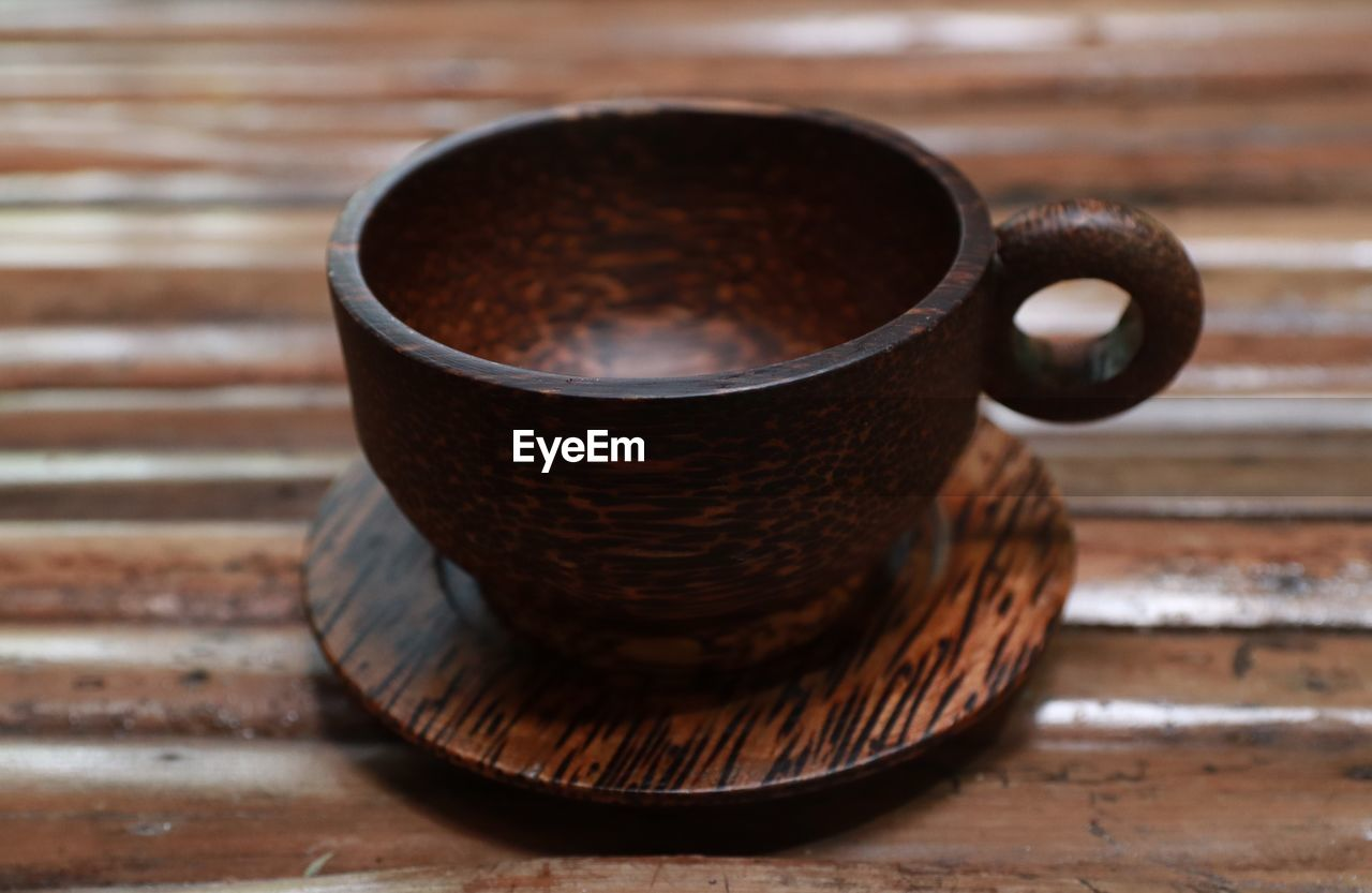 brown, still life, table, food and drink, wood - material, no people, drink, cup, refreshment, indoors, close-up, focus on foreground, coffee, mug, coffee - drink, coffee cup, freshness, day, handle, metal, non-alcoholic beverage, crockery, caffeine