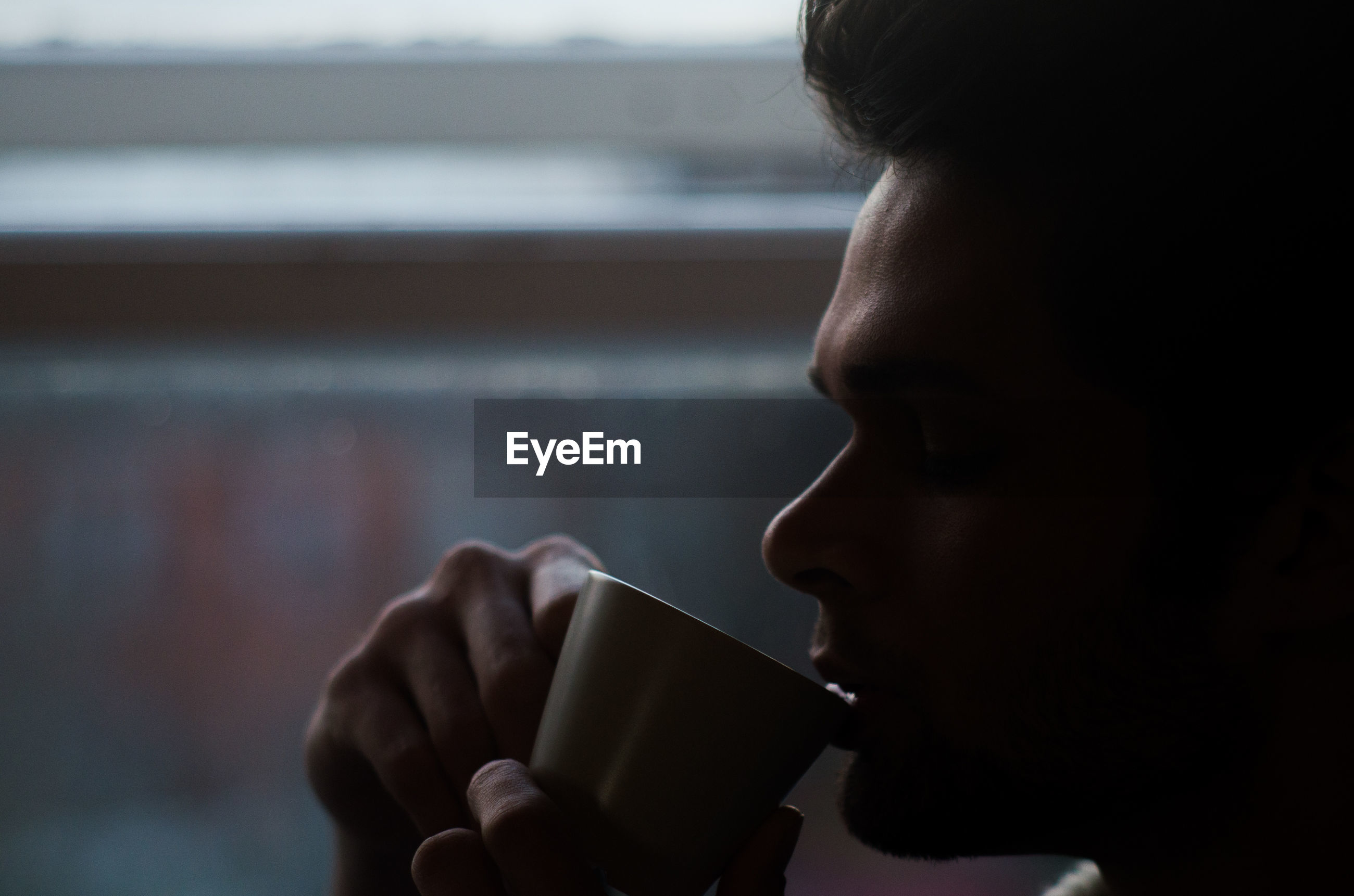 Close-up of man drinking coffee