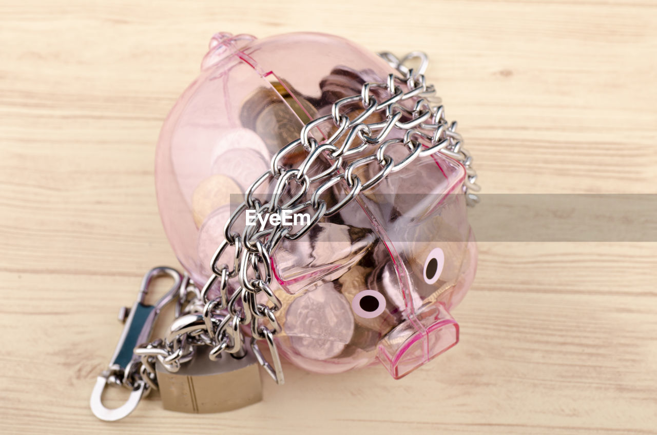 still life, close-up, no people, wood - material, metal, indoors, pink color, table, high angle view, representation, focus on foreground, toy, safety, day, chain, craft, large group of objects, human representation, security