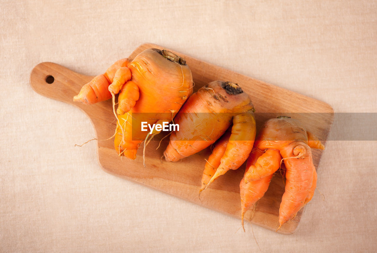 High Angle View Of Carrots On Cutting Board