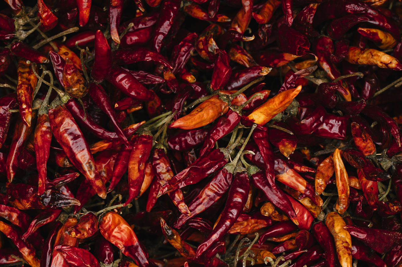 food and drink, food, spice, full frame, backgrounds, chili pepper, pepper, abundance, red, wellbeing, freshness, vegetable, red chili pepper, healthy eating, no people, large group of objects, still life, close-up, chili, high angle view