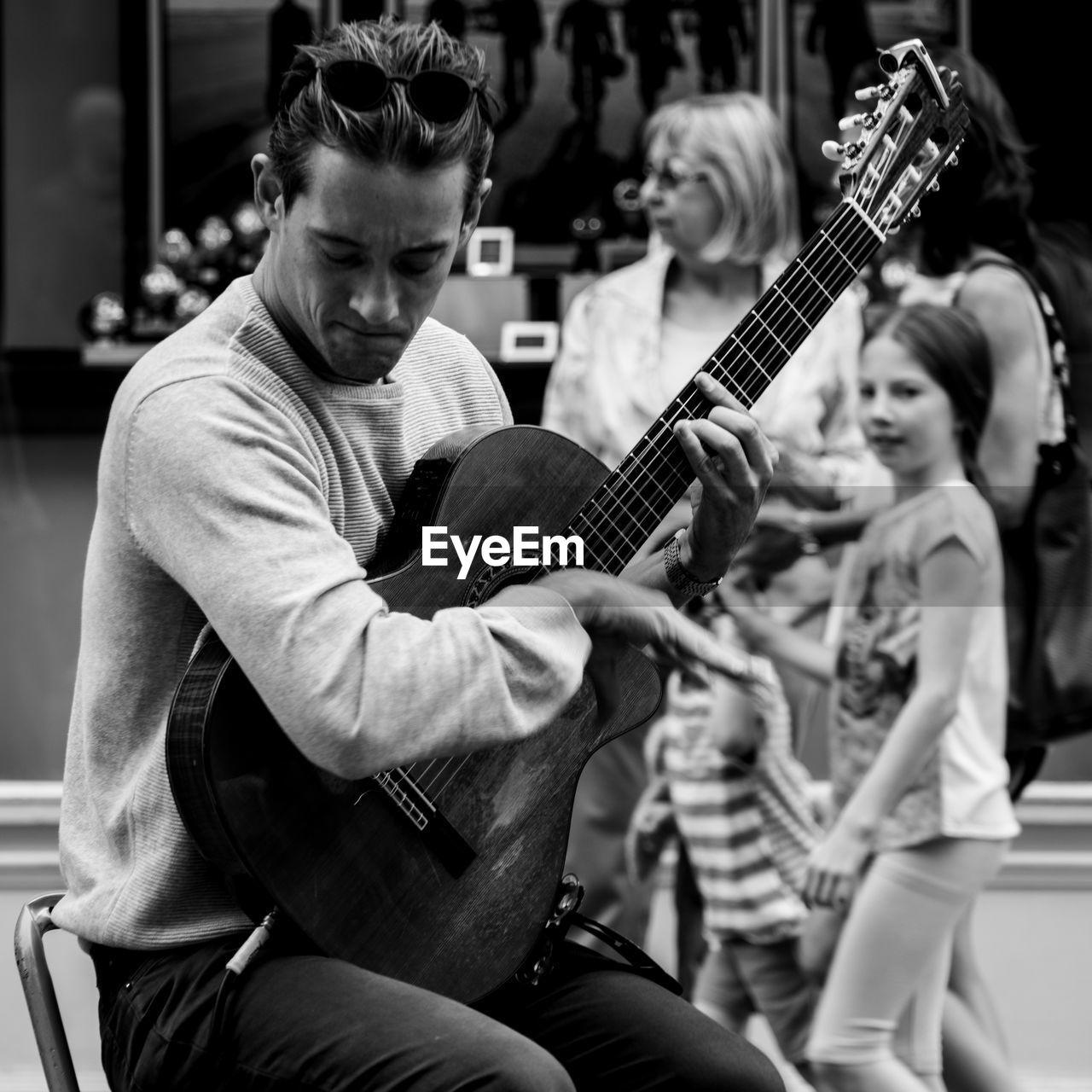 MEN PLAYING GUITAR