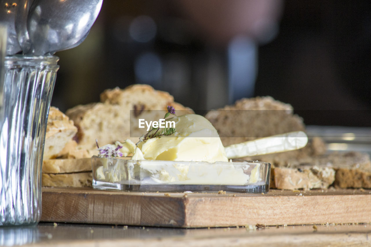 food, food and drink, freshness, dairy product, close-up, indoors, cheese, selective focus, ready-to-eat, wellbeing, healthy eating, still life, bread, eating utensil, no people, kitchen utensil, focus on foreground, table, household equipment, meal, glass, temptation, breakfast, snack, tray