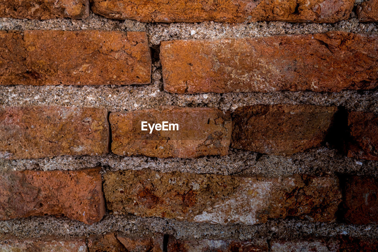 full frame, backgrounds, brick, wall, brick wall, wall - building feature, textured, no people, architecture, built structure, close-up, pattern, brown, solid, rough, in a row, stone wall, old, construction material, day, concrete