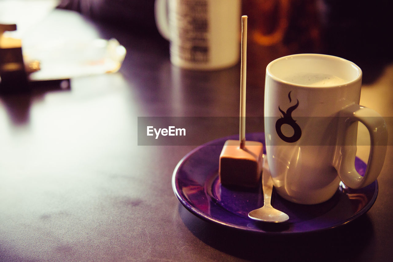 coffee cup, coffee - drink, drink, refreshment, table, cup, food and drink, indoors, saucer, focus on foreground, no people, close-up, freshness, frothy drink, day