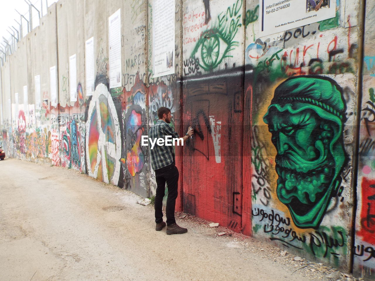graffiti, street art, art and craft, artist, spray paint, creativity, full length, multi colored, real people, men, building exterior, standing, architecture, built structure, lifestyles, one person, aerosol can, day, outdoors, spraying, painted image, city, adult, only men, people, adults only